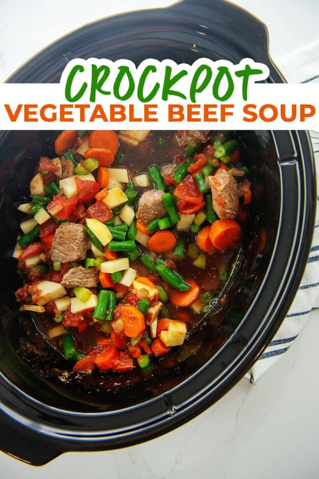 crockpot loaded with vegetables and beef.