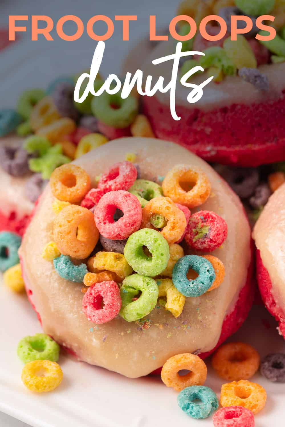 froot loops baked donuts piled on plate.