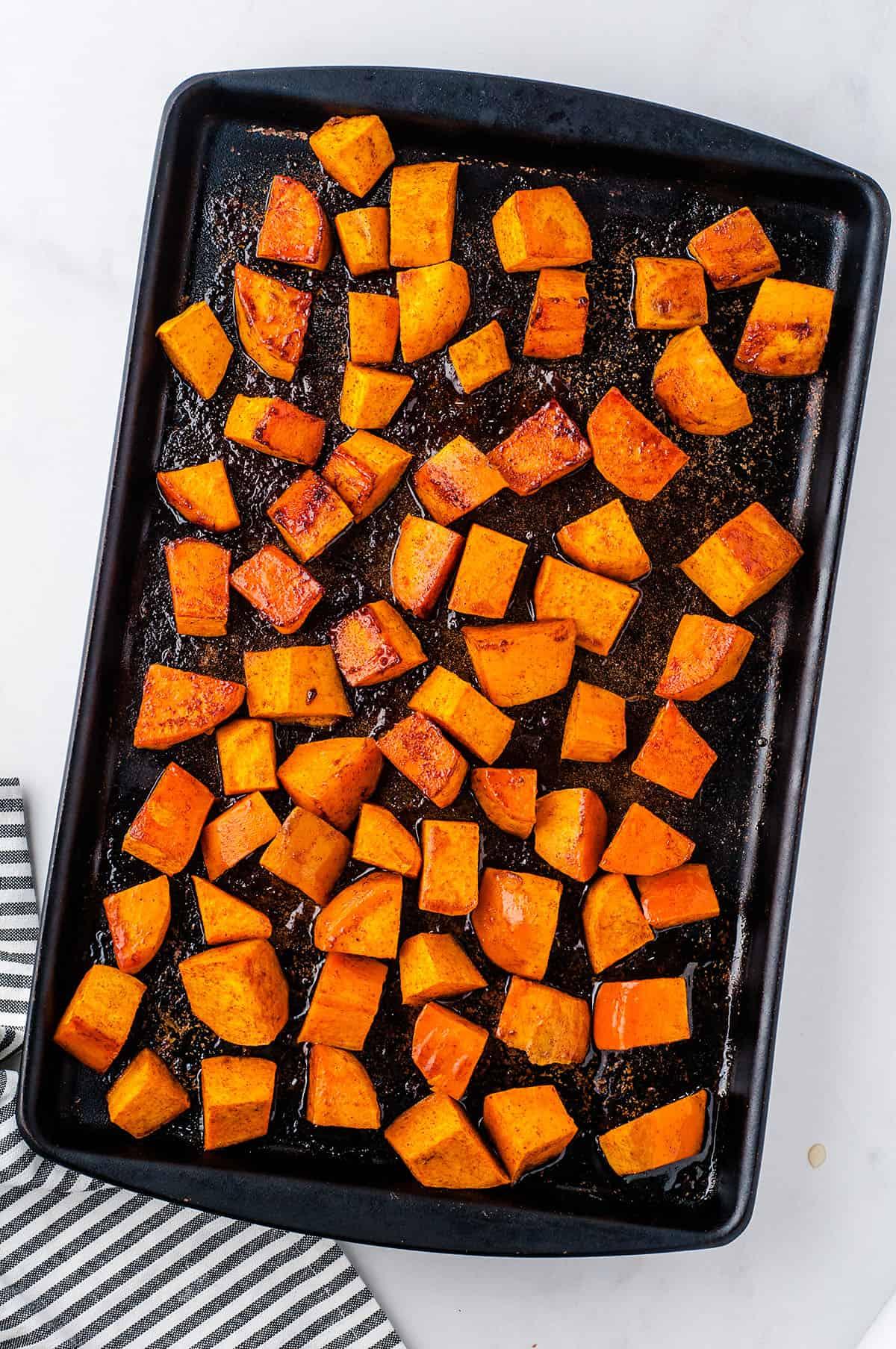 roasted sweet potatoes on sheet pan.