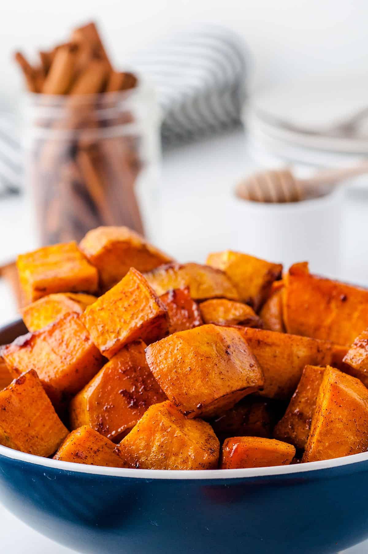 honey roasted sweet potatoes in blue bowl.