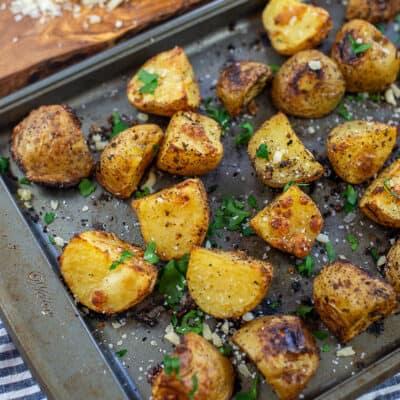 Parmesan roasted potatoes on metal baking sheet.